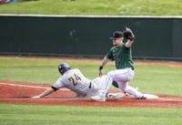 Ohio infielder, Rudy Rott (#26) attempts to tag out Toledo's Trace Hatfield (#24) during the doubleheader on Saturday, April 13. The Bobcats won 5-2.