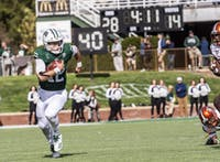 Nathan Rourke runs a ball during the homecoming game against the Bowling Green Falcons on Saturday.