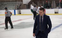 Ohio coach Sean Hogan shakes his head while leaving the ice after the Bobcats' game against Jamestown on Oct. 6. (FILE)