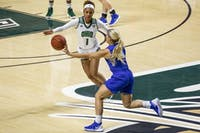 Ohio guard Cece Hooks (#1) defends Katie Collier (#14) of Middle Tennessee State during the second half of the Bobcats' game on Sunday, March 24 in The Convo. The Bobcats beat the Raiders 59-57 in the second round of the Women's National Invitational Tournament.