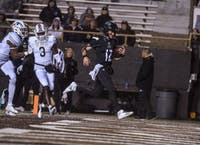 Ohio quarterback Nathan Rourke runs into the end zone for a touchdown Thursday night against Western Michigan at Waldo Stadium.