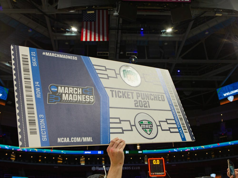 The Ohio Men's Basketball team celebrates winning the MAC Tournament Championship and earning its first bid to the NCAA Tournament since 2012 following an 84-69 victory over Buffalo at Rocket Mortgage FieldHouse on Saturday, March 13, 2021. ( Mijana Mazur - Ohio Athletics)