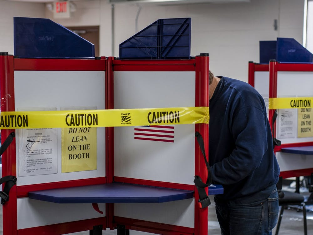 A voter at Chauncey Elementary School casts his ballot on Election day, Nov. 3, 2020.