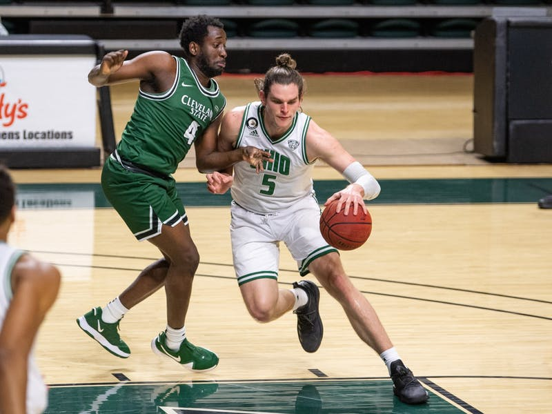 Ohio's Ben Vander Plas (#5) drives past Cleveland State's Franklyn Penn Jr. (#4) during the Bobcats' match versus Cleveland State in The Convo on Sunday, Dec. 6, 2020.