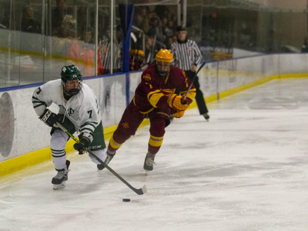 Ohio University forward, Gianni Evangelisti, handles the puck in the match against Iowa State University at Bird Arena on Friday, Oct. 25, 2019.