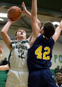 Athens High School sophomore center Justin Hynes (#32) goes up for a shot during the Bulldog's game against Wellston on Friday, February 3.