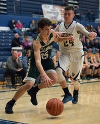 #15 (not on roster) drives to the basket against Wellston High School on January 13th, 2016 STAFF PHOTOGRAPHER|MATT STARKEY