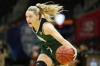 Ohio senior guard Taylor Agler (#0) drives to the basket during the Bobcats' 69-66 loss to Miami in the MAC Tournament in Cleveland on March 7. (FILE)