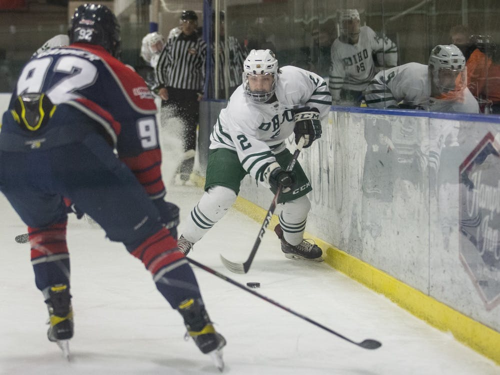 Ohio forward Nick Erker (#2) handles the puck in the offensive zone during the Ohio Bobcats game against the Liberty Flames on Friday, March 5, 2021, at the Bird Arena in Athens, Ohio