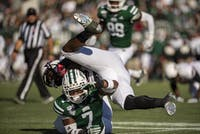 Ohio University safety Javon Hagan (No. 7) tackles a Northern Illinois University offensive player on Saturday, Oct. 12, 2019. The Bobcats lost 39-36.