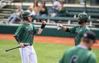 Ohio infielders, Michael Richardson (#8) and Sebastian Fabik (#34) fist bump after scoring during the first game of the doubleheader against Toledo on Saturday, April 13. The Bobcats won 5-2.