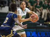 Ohio's Amani Burke (#3) looks to pass while being guarded by Akron's Shaunay Edmonds (#3) on Feb. 6. (FILE)