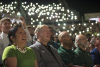 (From left) Ohio University Vice President for Diversity and Inclusion Gigi Secuban, President Duane Nellis, Vice President of Student Affairs Jason Pina, and Executive Vice President and Provost Chaden Djalali watch a video welcoming the class of 2022 to campus during Convocation on Aug. 26, 2018. FILE