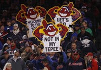 After a long and controversial history, the Cleveland Indians announced on Jan. 29, 2018 it will no longer be using the Chief Wahoo logo after the 2018 season. Here, Cleveland fans hold up signs during the 2016 World Series.