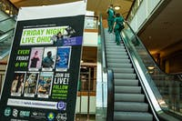A Friday Night Live Ohio advertisement is set up between escalators inside Baker University Center.