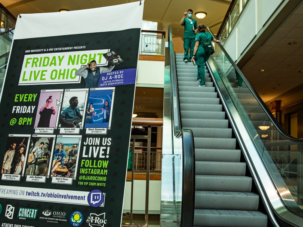 A Friday Night Live Ohio advertisement is set up between escalators inside Baker University Center.
