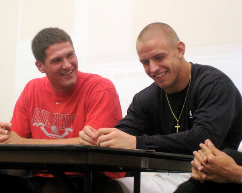 James Laurinaitis (right side) laughs