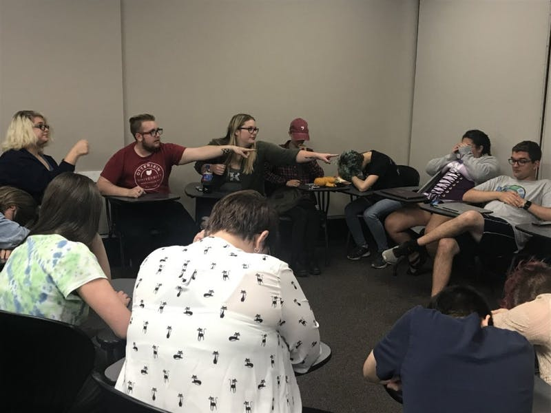 Otterbein student organization Gamer's Guild plays Ultimate Werewolf, a game where wolves choose which civilians to kill at night.