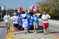 Phi Delta Theta march in Homecoming parade