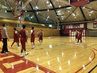 Men's basketball team practicing for match against Ohio Wesleyan