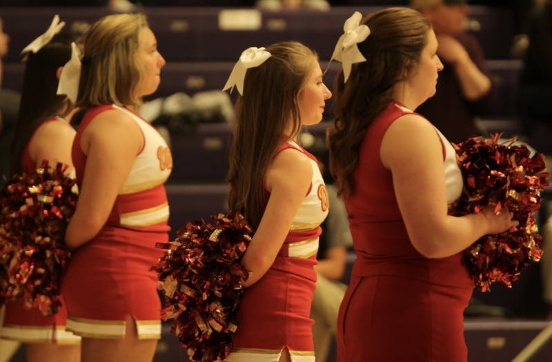 As both of Otterbein's basketball teams traveled to Bexley, the Cardinals' cheerleading squad cheered along the baseline.