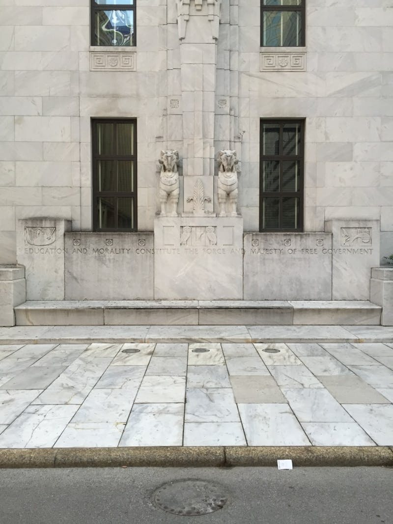 Pictured: Ohio State Courthouse, inscription reads: Education and morality constitute the force and majesty of free government.