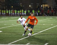 Junior midfielder Tiger Pham fights for possession.