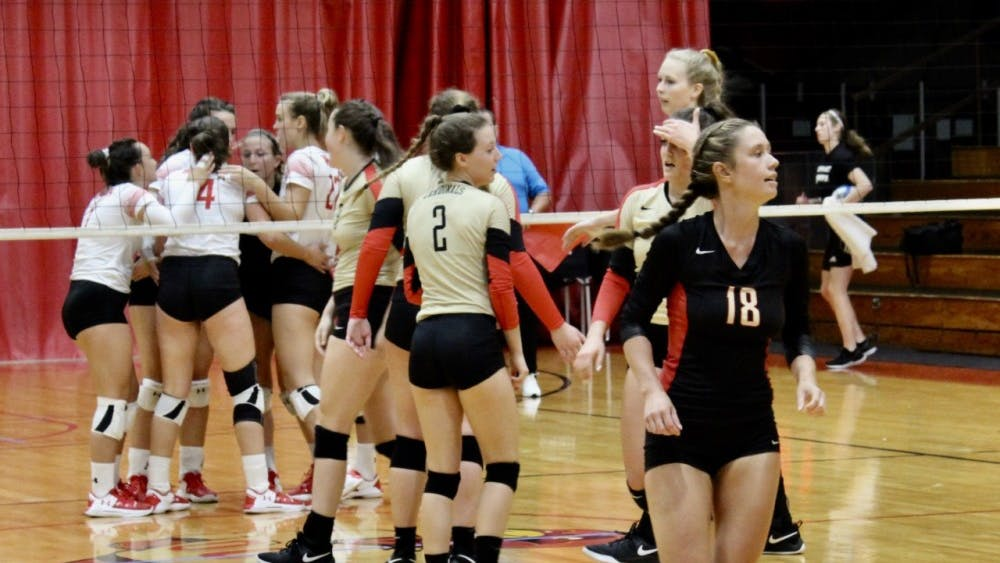 Lone senior and libero Ashlyn Leon (#18) represented the current Otterbein volleyball team in the alumni match at Homecoming.