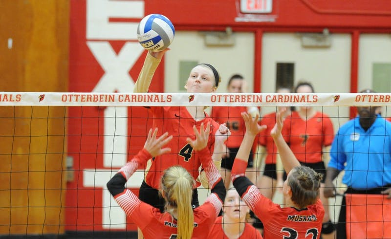 Otterbein junior Emily Shuk spikes ball against Muskingum