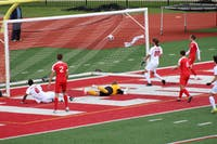 Players from both teams watch as the ball glides into the net for Otterbein's fifth goal. This was the final goal of the game and was scored by #8, Kamal Mohammed.