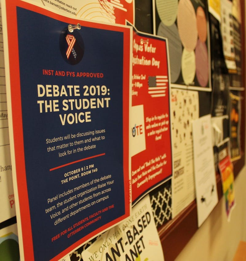 Scattered around campus are posters for student events related to the October Democratic debate at Otterbein.