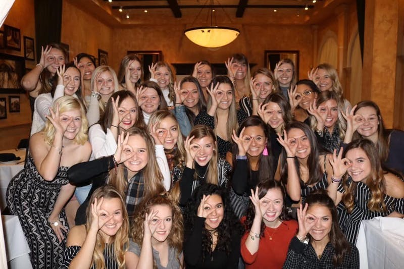Lefkovitz poses with Sigma Alpha Tau sorority sisters at fall 2018 activiation lunch