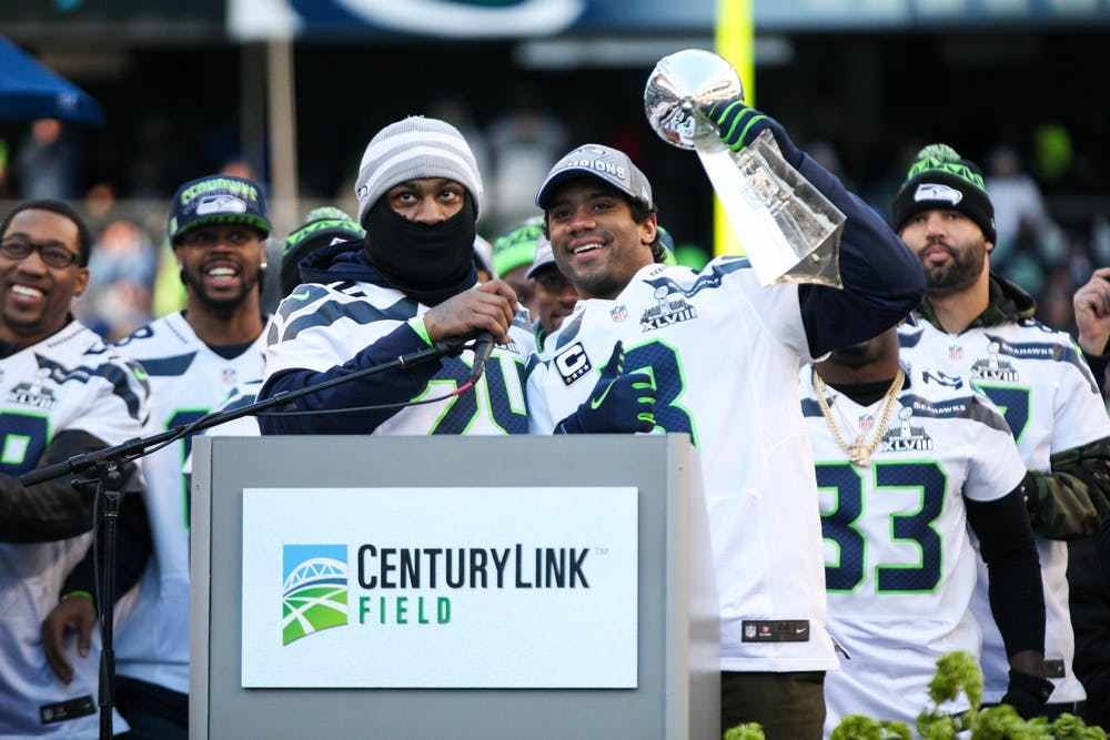 "<p>Marshawn Lynch (left) celebrates the Super Bowl XLVIII victory alongside quarterback Russell Wilson (right).</p> <h6>Photo Credit: andrewtat94 / <a href=""https://www.flickr.com/photos/aftfalcodog/12336362635/"" target=""_self"">Flickr</a></h6>"