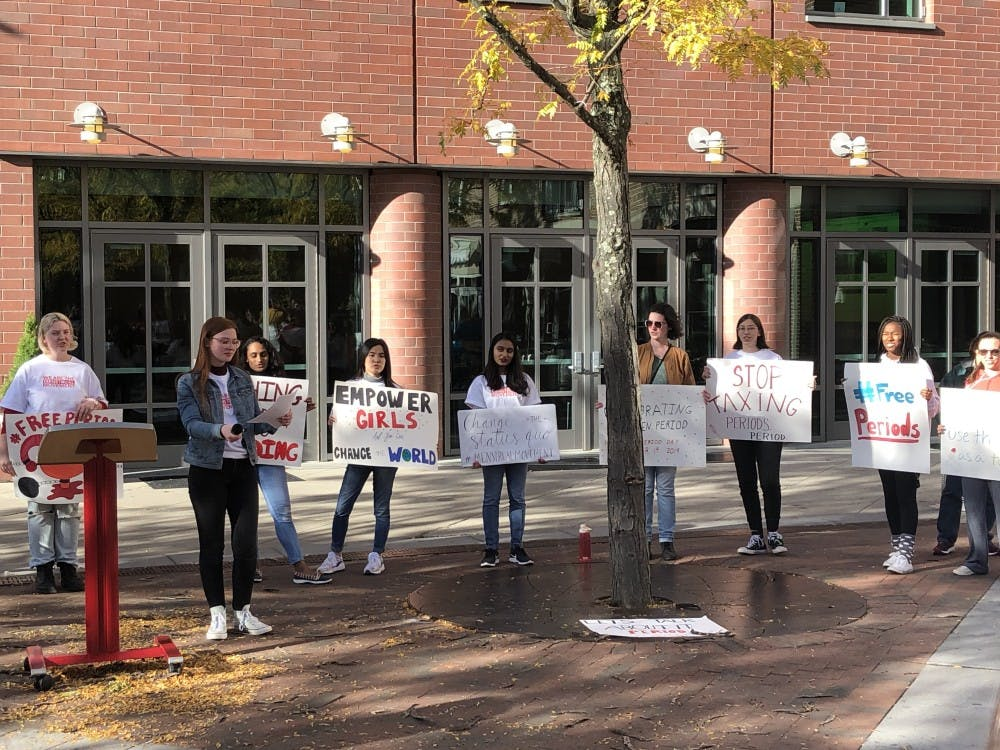 <p>Bridget Hoyt leads the rally in chants as participants hold signs behind her.</p> <h6>Photo Credit: Paige Allen / The Daily Princetonian</h6>