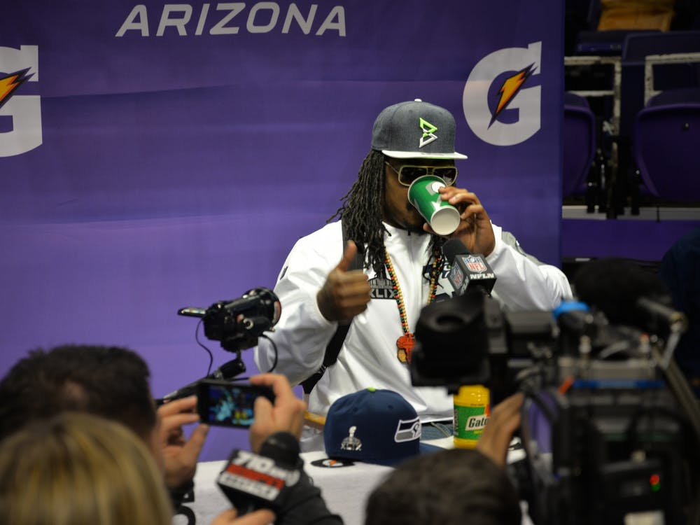 Marshawn Lynch in a 2015 press conference Photo Credit: Jeremy Vandroff - WEBN-TV / Flickr