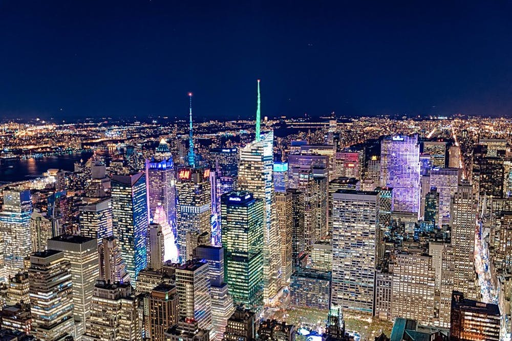 """<h6>""""New York City Skyline from Top of Empire State Building"""" by Jody Claborn / <a href=""""https://www.flickr.com/photos/130478877@N02/23347480891/in/photolist-S1YbWf-2dUrqWn-2eRJ4fc-2cLCVay-Bz8WDZ-2dwRxH5-2dUzoWK-sehxWn-c3L25q-c3L2YQ-cDKVt9-cDKWvL-offZ5U-RDBtSX-HVrvRk-oVf1E1-6c5bc9-g35gg7-9me4hv-2fp2ukU-cDKGUf-yupgyU-PdHKhn-9qYD4U-vSUeLr-yML7J8-freMEz-B3Fx9C-ciosWU-waEopP-cDKXoG-DsKz4P-ciosZG-cDKWQ9-biW9vT-yunjf1-qZ1L5w-seshZ4-ciox8h-dGdriP-2aicKDi-ciotMG-6c12yT-c3GmK7-d4L8wW-sb3ug6-yupbPJ-qEDioJ-c3Jz6s-c3JB7Y"""" target=""""_self"""">Public Domain</a></h6>"""