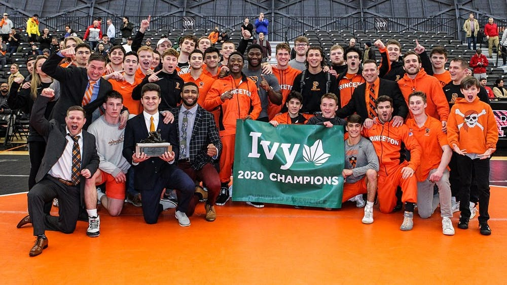 Princeton wrestling, with its first Ivy League trophy since 1986. Photo credit: Beverly Schaefer, GoPrincetonTigers.