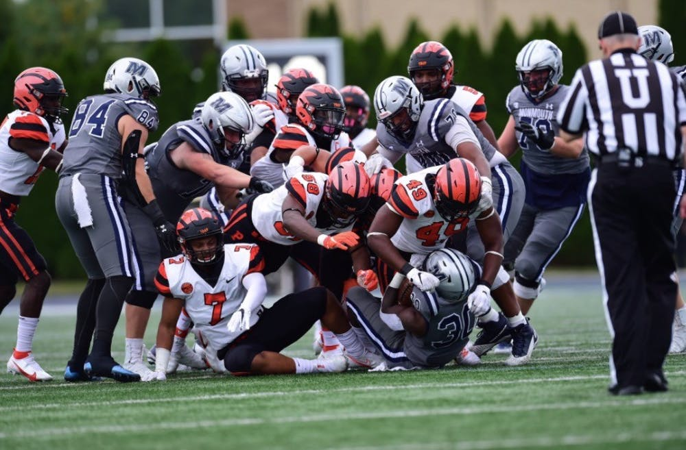 <h5>No. 49 Uche Ndukwe and others on Princeton's defense were key to the team's late comeback against Monmouth.</h5> <h6>Courtesy of @princetonftbl/Twitter</h6>
