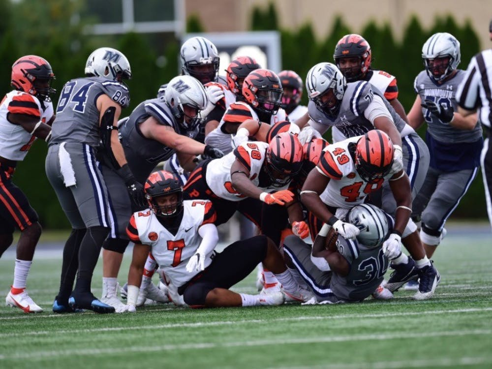 No. 49 Uche Ndukwe and others on Princeton's defense were key to the team's late comeback against Monmouth. Courtesy of @princetonftbl/Twitter