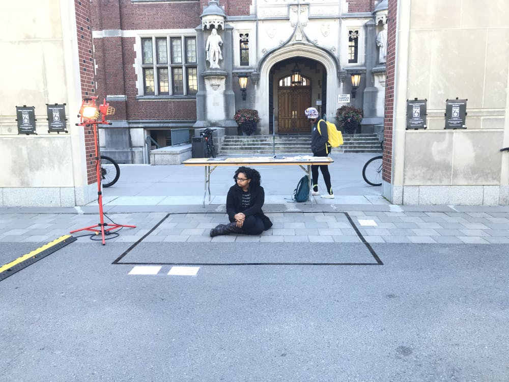 Nicole Williams '22 participates in the 7x9 protest outside of Frist Campus Center at 11 AM on Friday, 10/19.