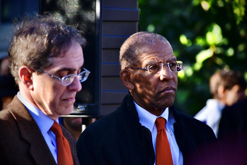 "<h5>University President Christopher Eisgruber '83 and then-Trustee Brent Henry '69 stand together at the dedication of ""Double Sights"" in Oct. 2019.</h5> <h6>Jon Ort / The Daily Princetonian</h6>"