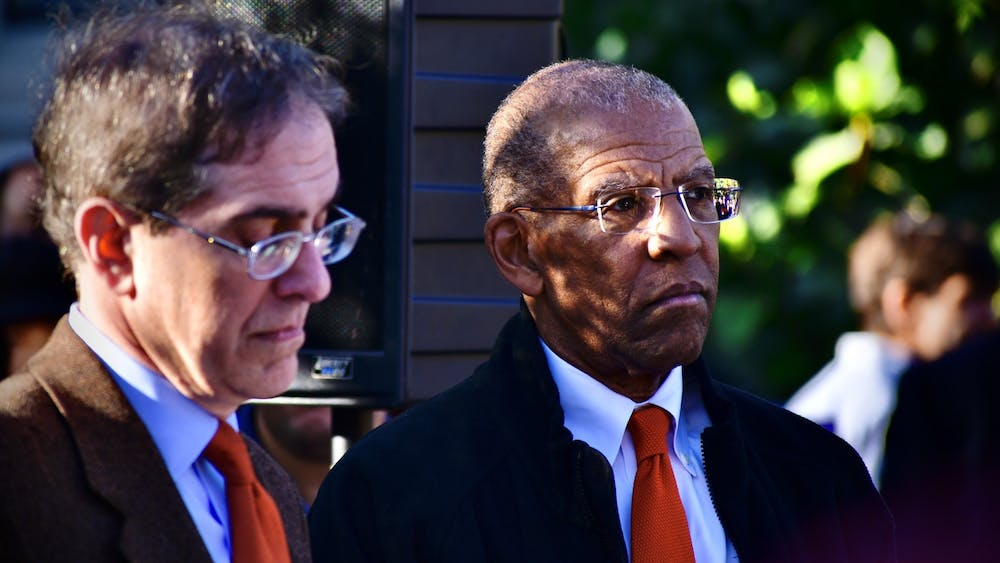 """University President Christopher Eisgruber '83 and then-Trustee Brent Henry '69 stand together at the dedication of """"Double Sights"""" in Oct. 2019. Jon Ort / The Daily Princetonian"""