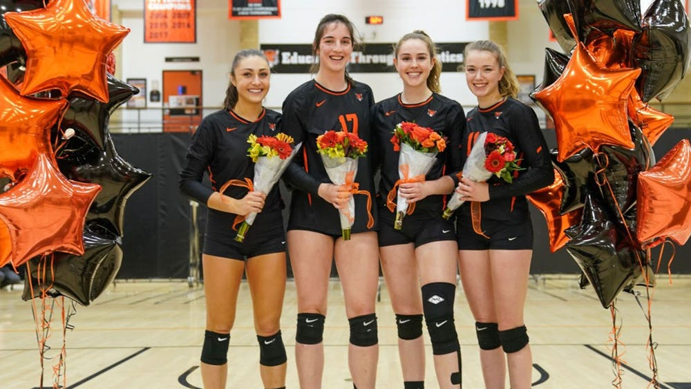Jessie Harris, Maggie O'Connell, Devon Peterkin and Natasha Skov during Saturday's celebration for the team's seniors. The quad has won two Ivy League titles together. Photo by Noel Valero / GoPrincetonTigers.com