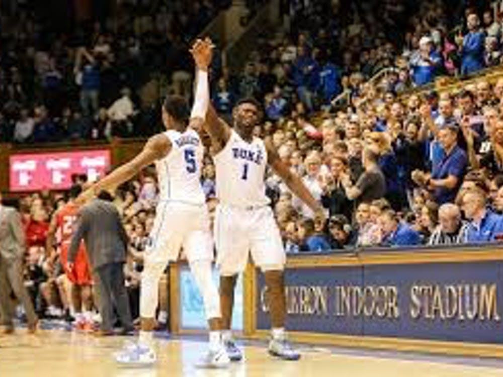 Zion Williamson high-fives teammates RJ Barrett