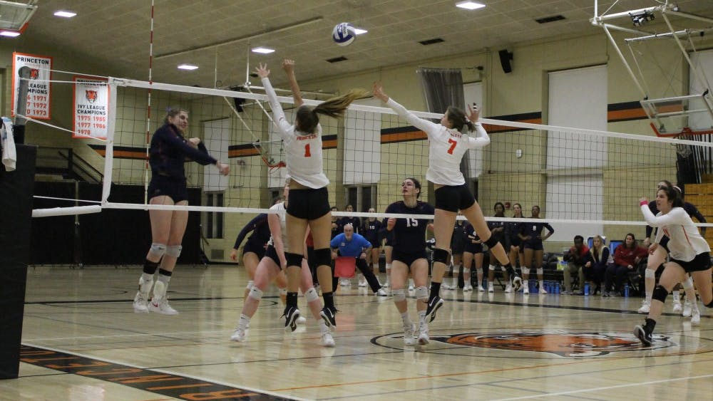 Alexa Underwood and Caroline Sklaver defend the net against Penn