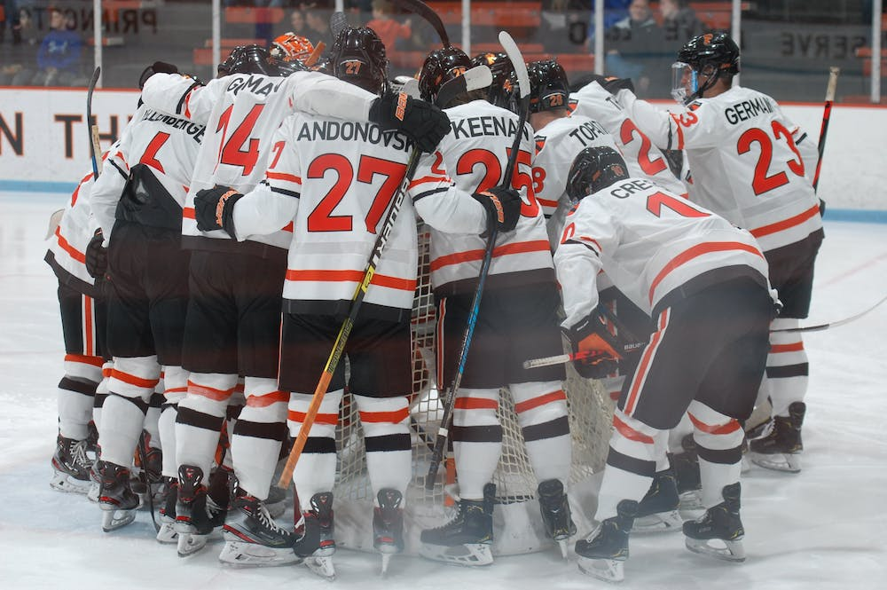 Men's hockey starters huddle before a game at Baker Rink. Photo by Tom Salotti / Daily Princetonian