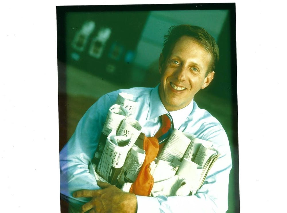 <p>William Rice Elfers '71 in the mid-1990s, holding a number of newspapers published under Community Newspaper Company.&nbsp;</p> <h6>Courtesy of Richard W. Thaler, Jr. '73</h6>
