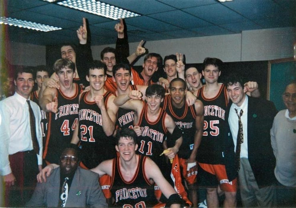 "<h5>The Tigers celebrate after beating UCLA 43-41 in the 1996 NCAA Tournament.&nbsp;</h5> <h6>Photo courtesy of <a href=""https://paw.princeton.edu/podcast/pawcast-mens-basketball-alums-revisit-96-princeton-ucla-game"" target=""_self"">Ben Hart</a> '96</h6>"