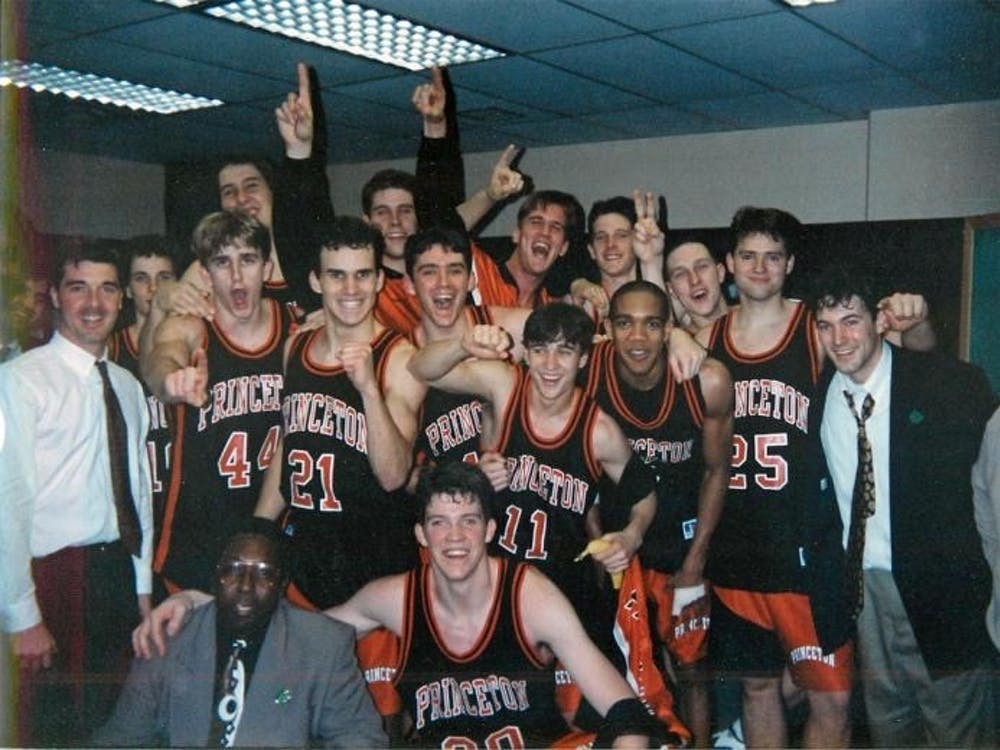 The Tigers celebrate after beating UCLA 43-41 in the 1996 NCAA Tournament.  Photo courtesy of Ben Hart '96
