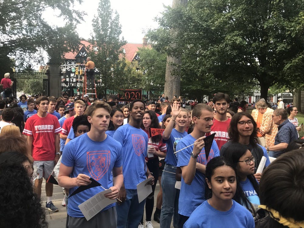 <p>The Class of 2023 enters en masse through FitzRandolph gates.</p> <p><br></p> <p>Zack Shevin / The Daily Princetonian</p>